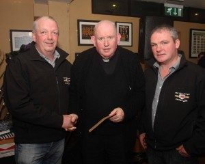 Fr Eddie Gallagher PP KIlcar receives a cheque for the Carrick Sheltered Housing for E360 from Brendan Byrne and Aaron O'Shea on the Midwest Donegal Vintage Club, part proceeds of their Kilcar Tractor run. (John/jmac.ie)
